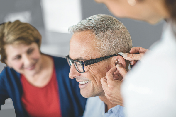 An older man having his hearing tested and investigating the cause of his hearing loss.