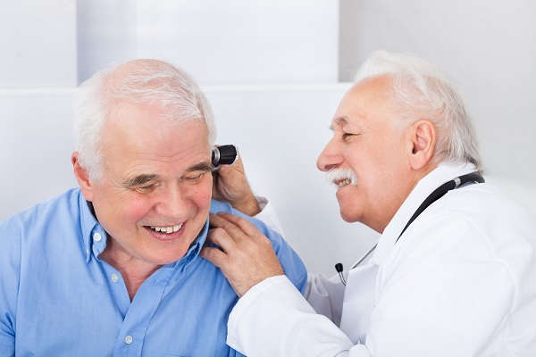 a man being tested for sensorineural hearing loss.