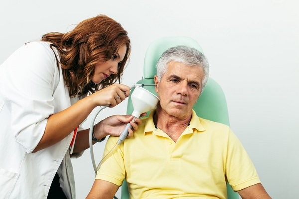 a ear syringing procedure being carried out on a patient